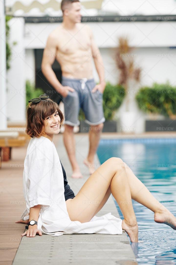 Beautiful Happy Woman Sitting At Pool: Stock Photos