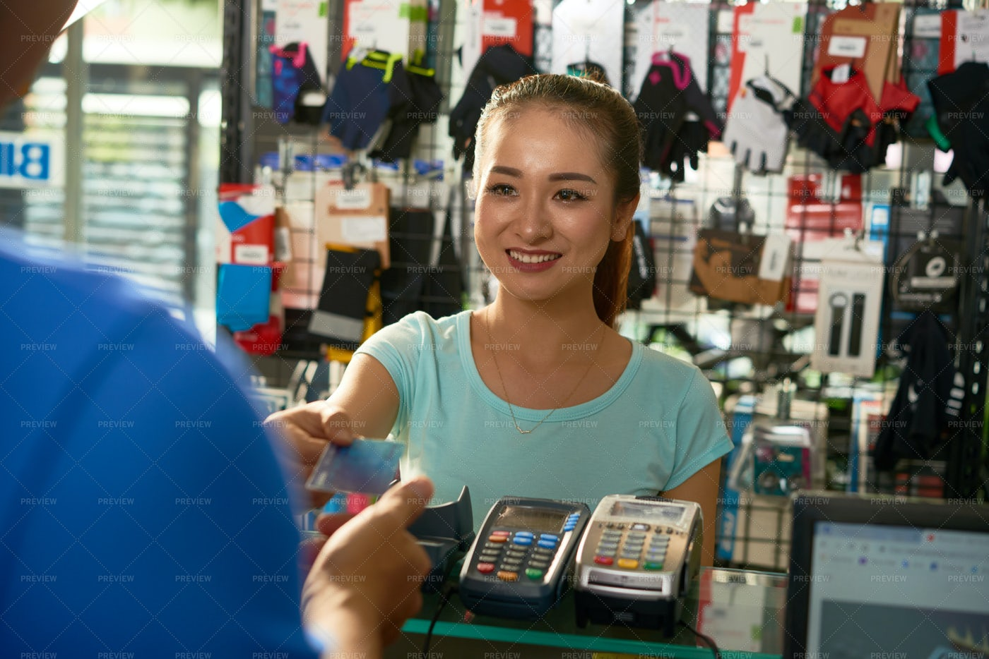 Customer Paying For Purchase With Card: Stock Photos