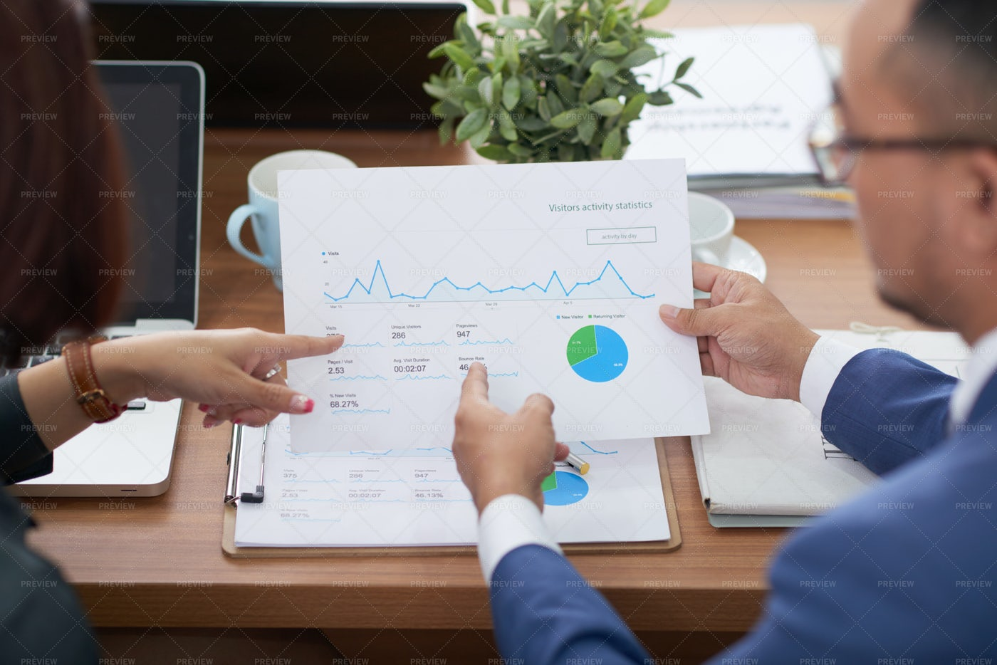 People Discussing Financial Graphs: Stock Photos