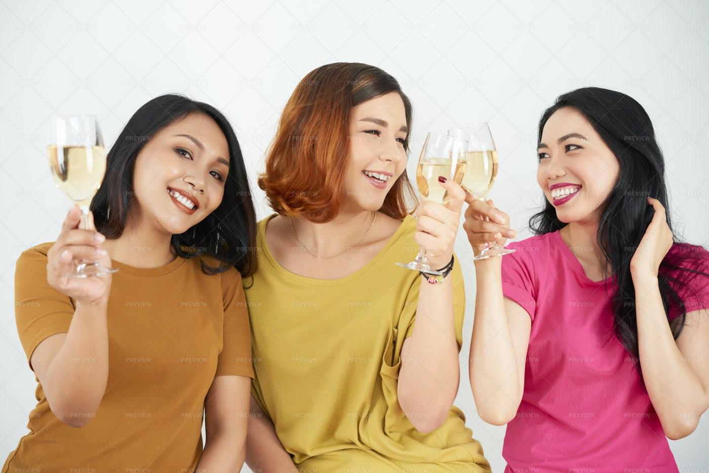 Happy Friends Drinking Wine: Stock Photos