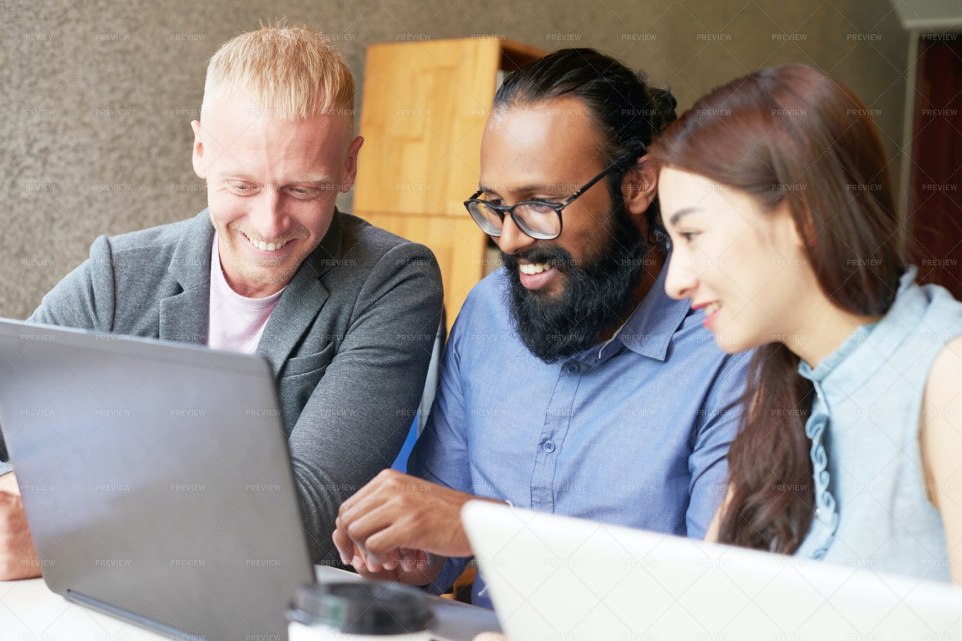 Cheerful Colleagues Watching: Stock Photos