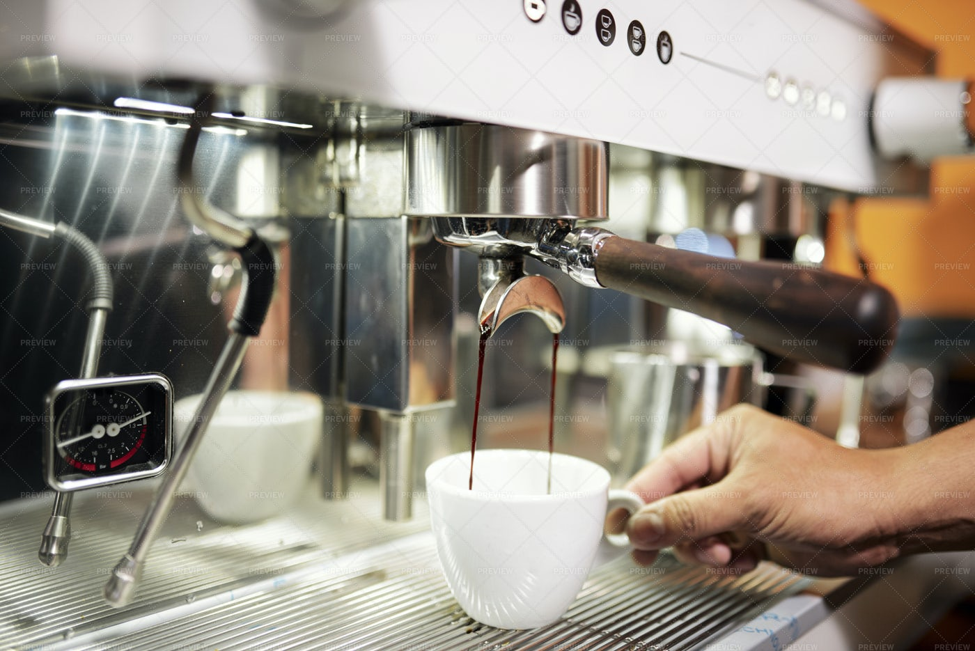 Barista Pouring Coffee In Cup: Stock Photos