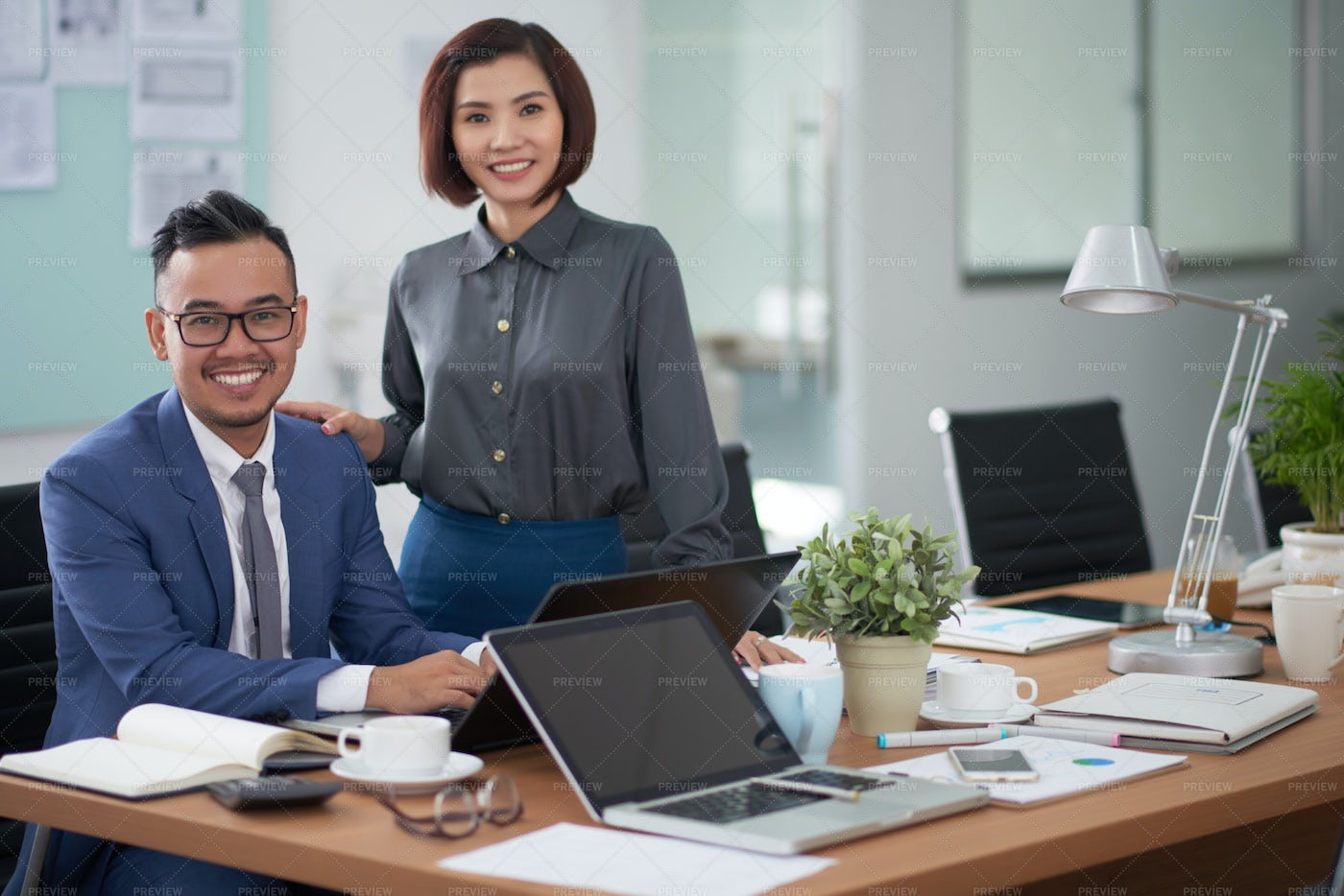 Successful Business Partners At Office: Stock Photos