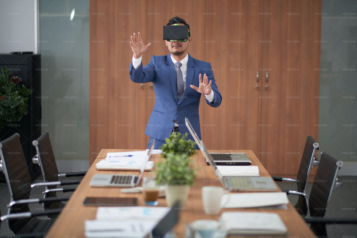 Businessman Playing In Virtual Games: Stock Photos