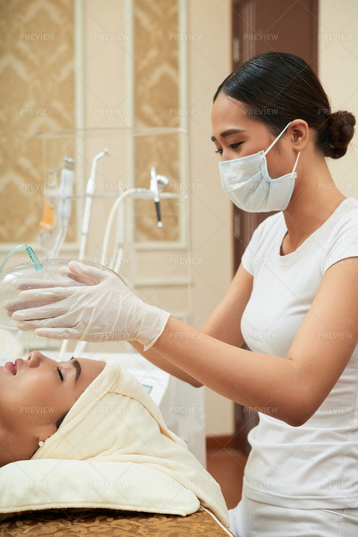 Cosmetologist Making Facial Procedure: Stock Photos
