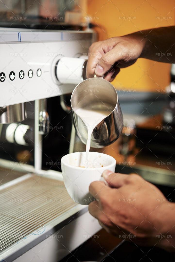 Barista Making Coffee With Milk: Stock Photos