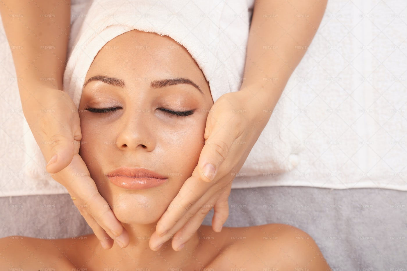 Woman Getting Massage For Face: Stock Photos