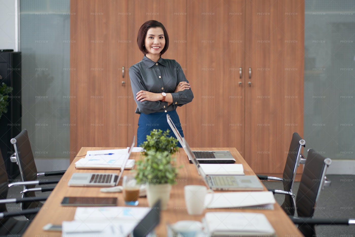 Female Executive Standing In Boardroom: Stock Photos