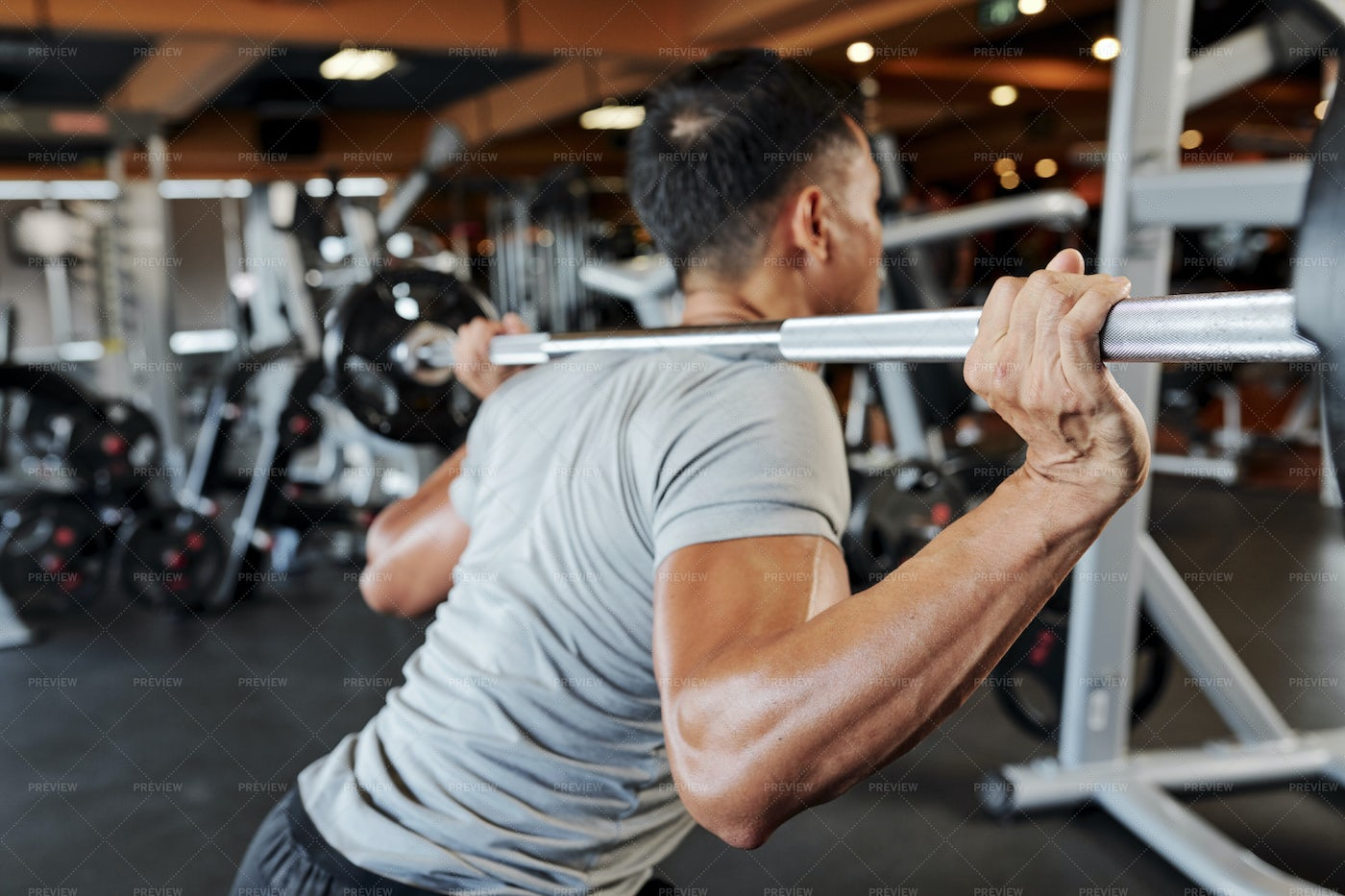 Man Exercising With Barbell: Stock Photos