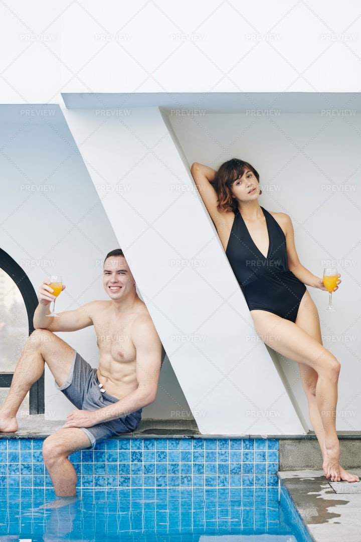 Young Couple Resting At Swimming Pool: Stock Photos