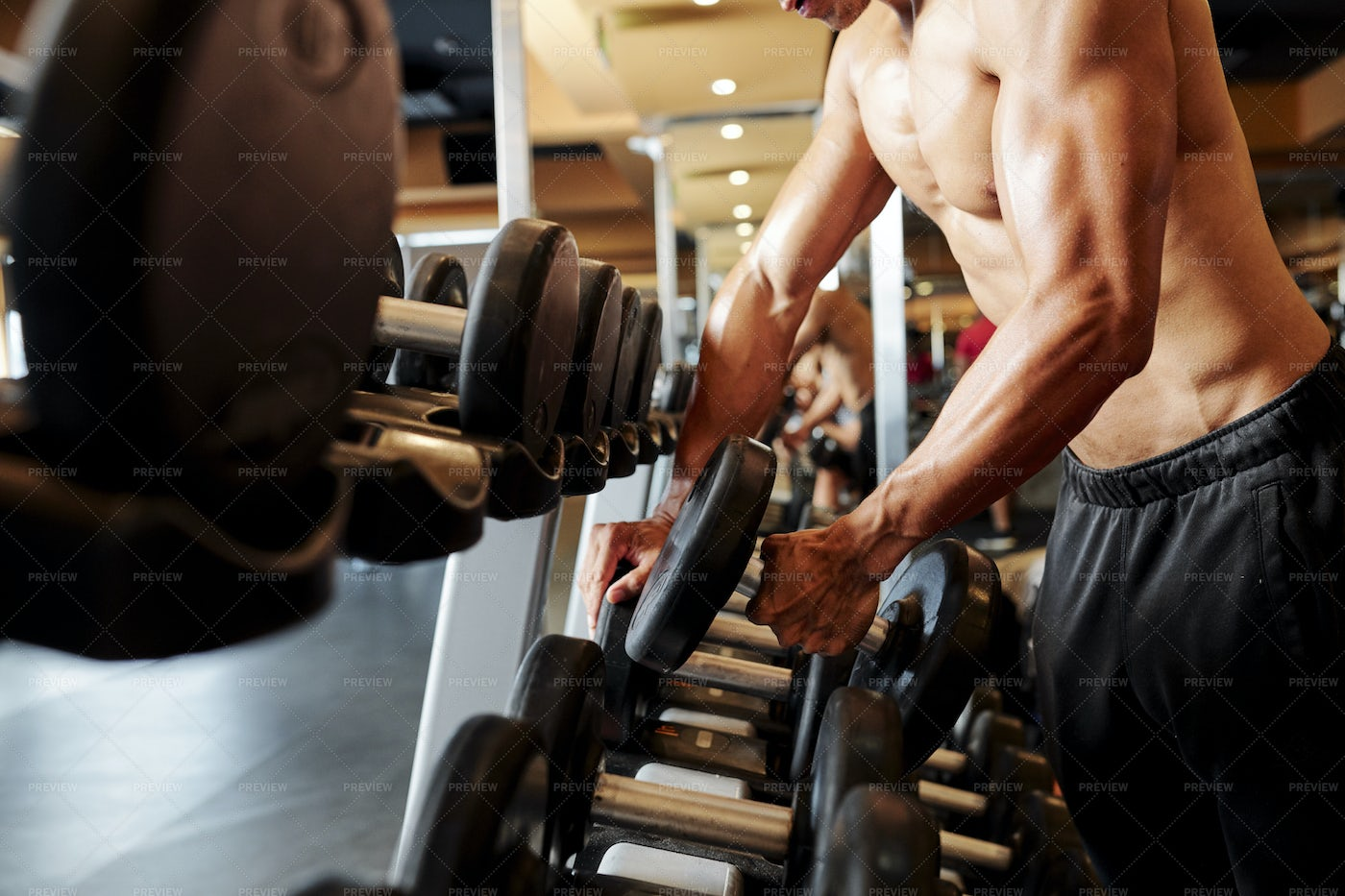 Bodybuilder Training With Dumbbell: Stock Photos