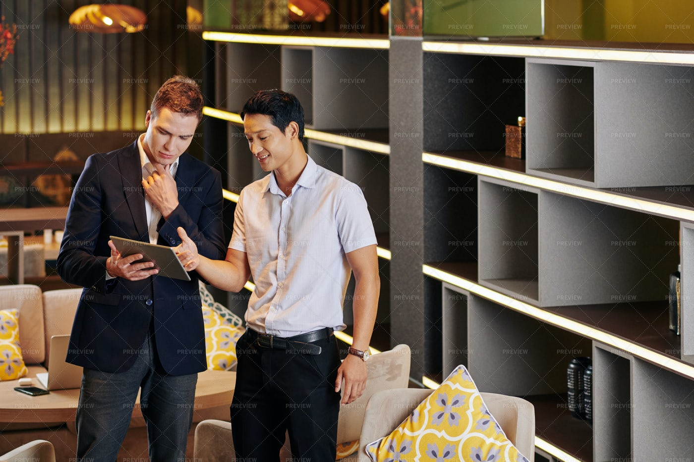 Entrepreneurs Discussing Documents: Stock Photos