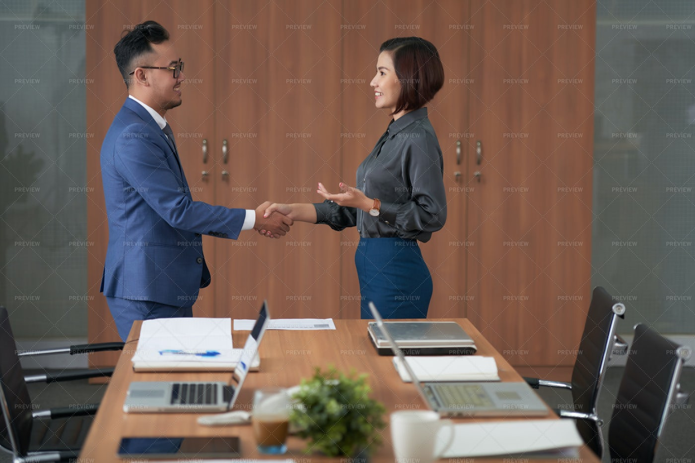Business Partners Shaking Hands At: Stock Photos