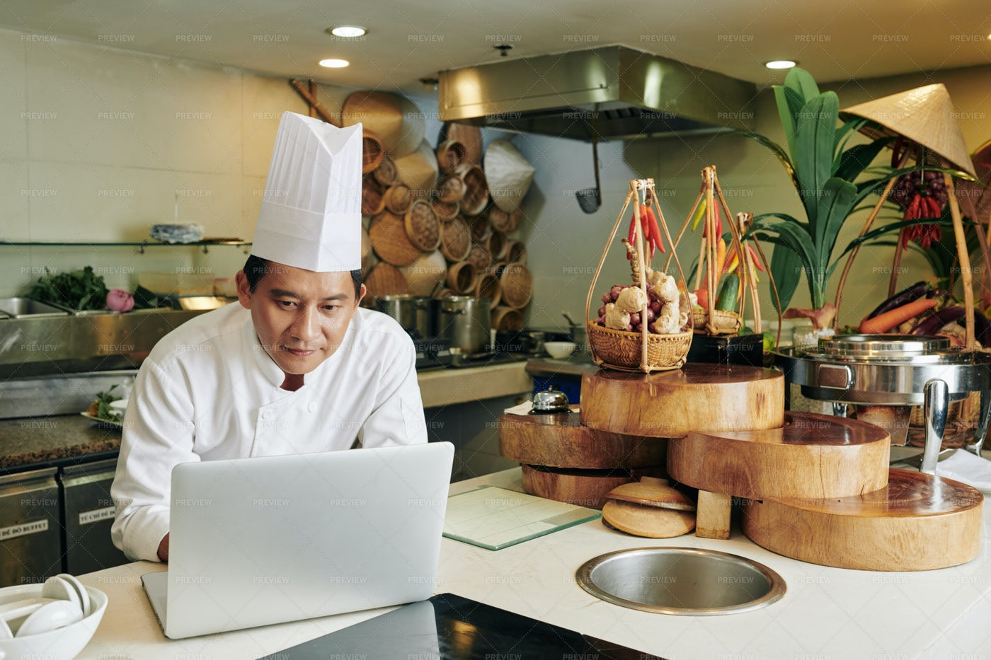 Asian Chef Working On Laptop: Stock Photos