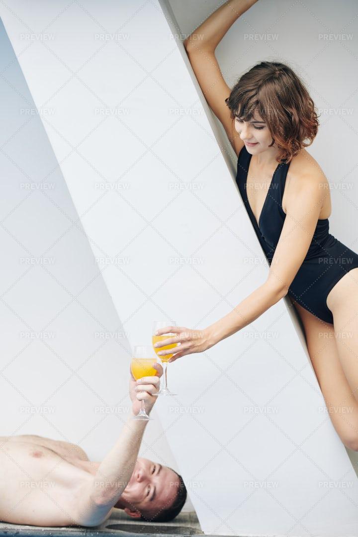 Young Couple Enjoying Cocktails When: Stock Photos