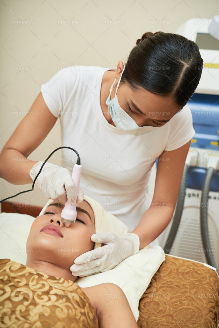 Cleaning Of Face With Ultrasound: Stock Photos