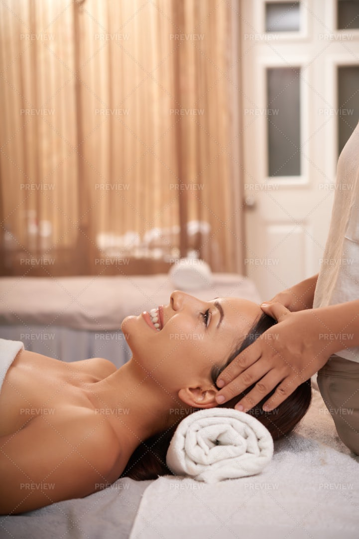 Woman Getting Massage For Her Head: Stock Photos