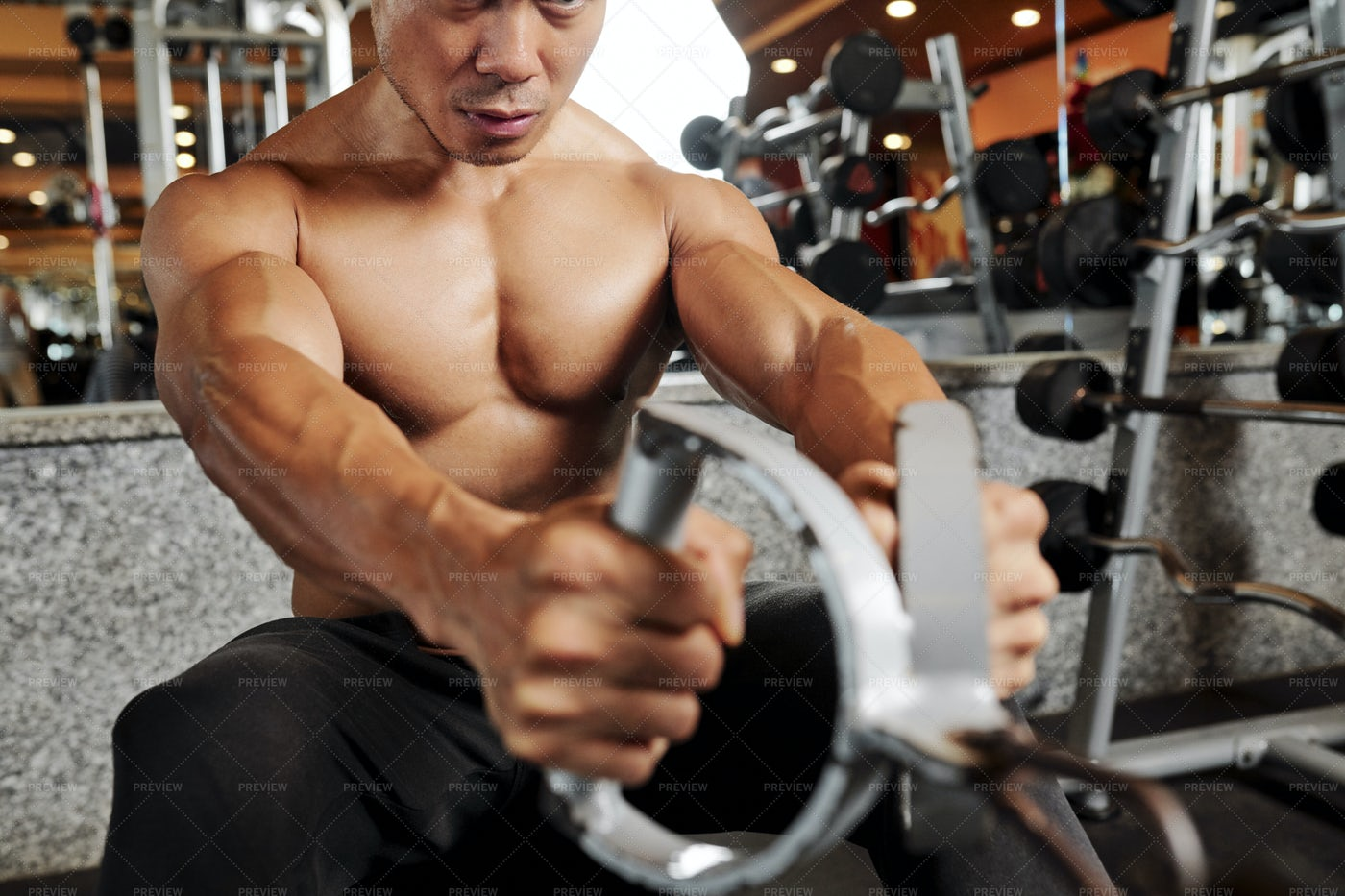 Man Building Muscles In Gym: Stock Photos