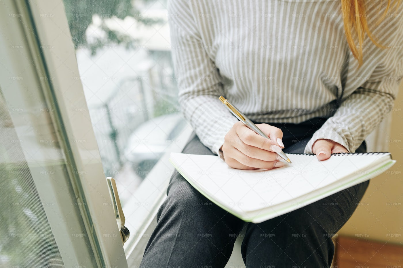 Young Woman Drawing In Sketchbook: Stock Photos