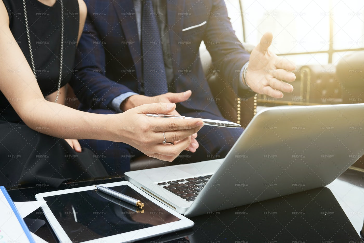 Business Team Discussing Work: Stock Photos