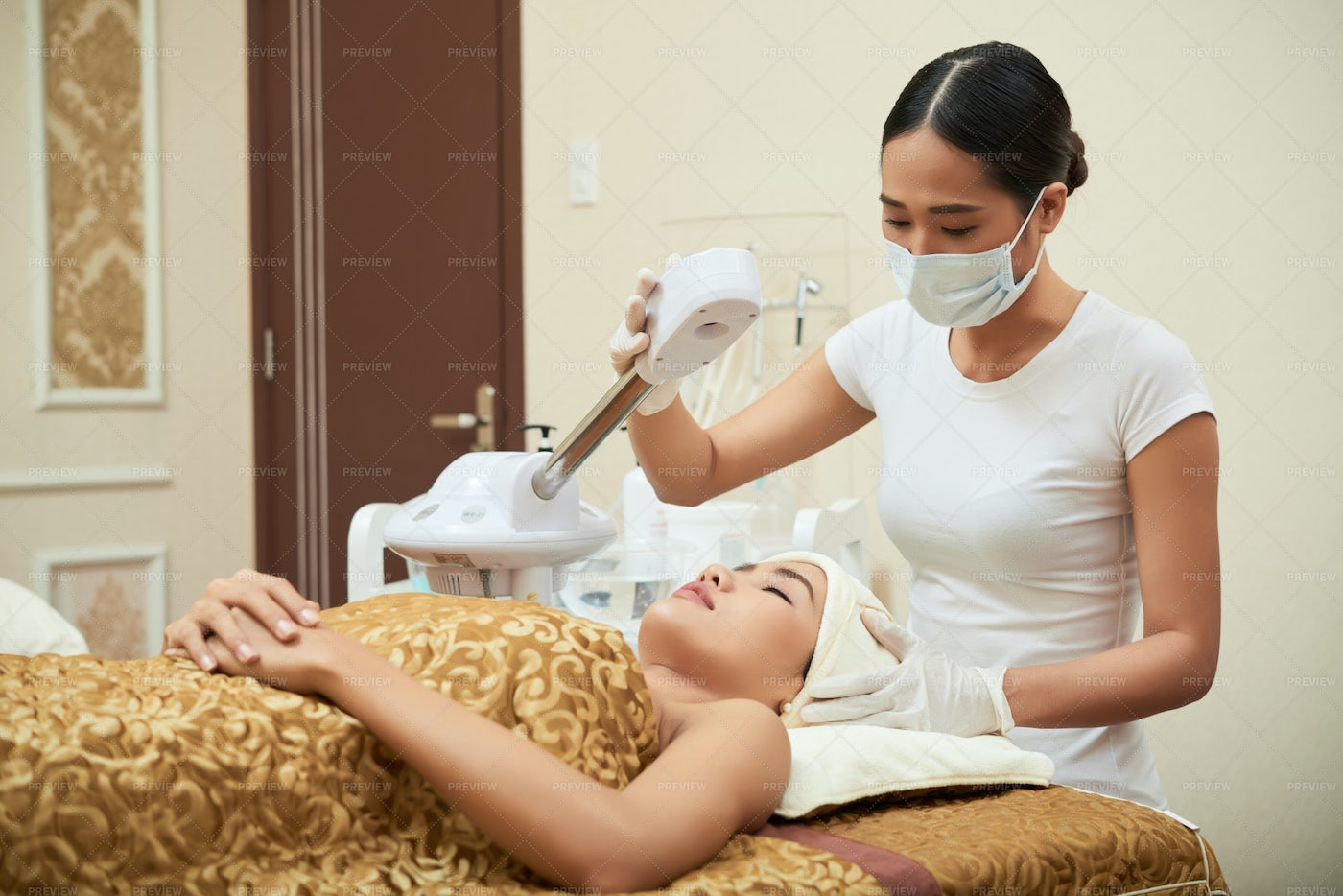 Laser Therapy In Spa Salon: Stock Photos