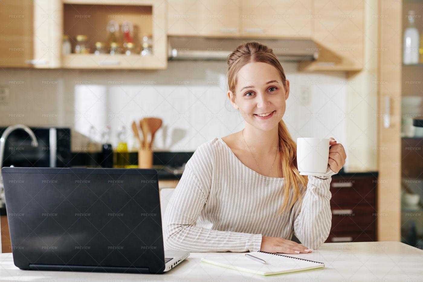 Pretty Woman At Kitchen Table: Stock Photos