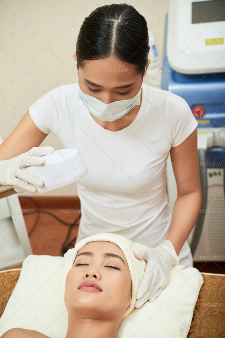 Laser Therapy For Face In Spa Salon: Stock Photos