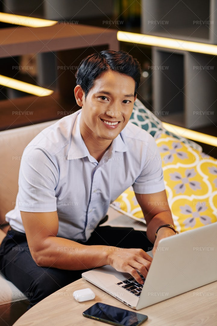 Young Man Working On Laptop: Stock Photos