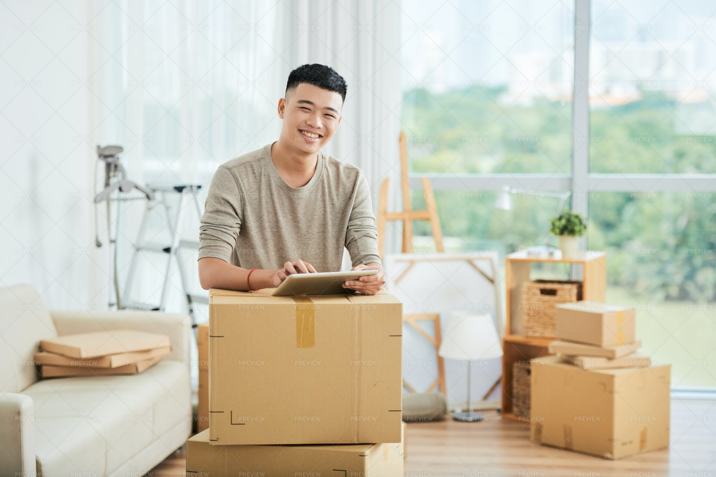 Asian Man With Packed Boxes: Stock Photos