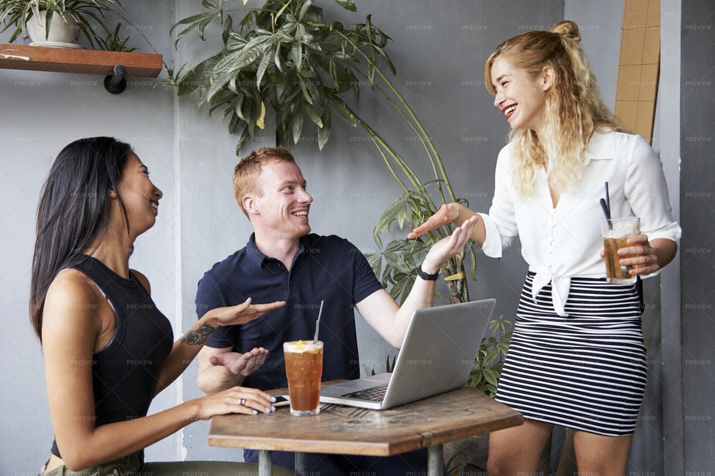 Young People Joking Around In Cafe: Stock Photos
