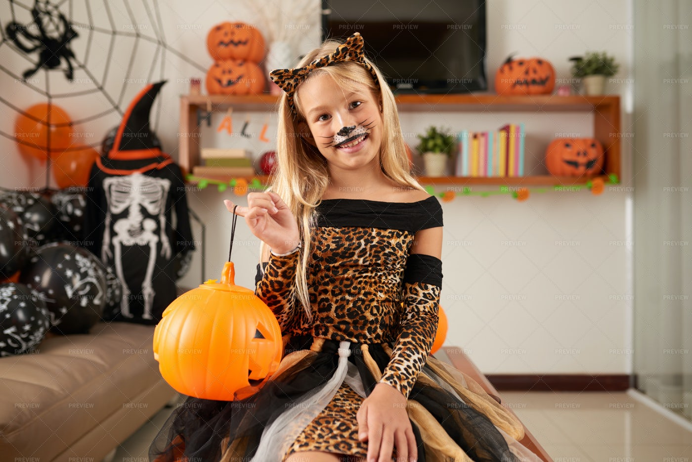 Little Girl Celebrating Halloween: Stock Photos