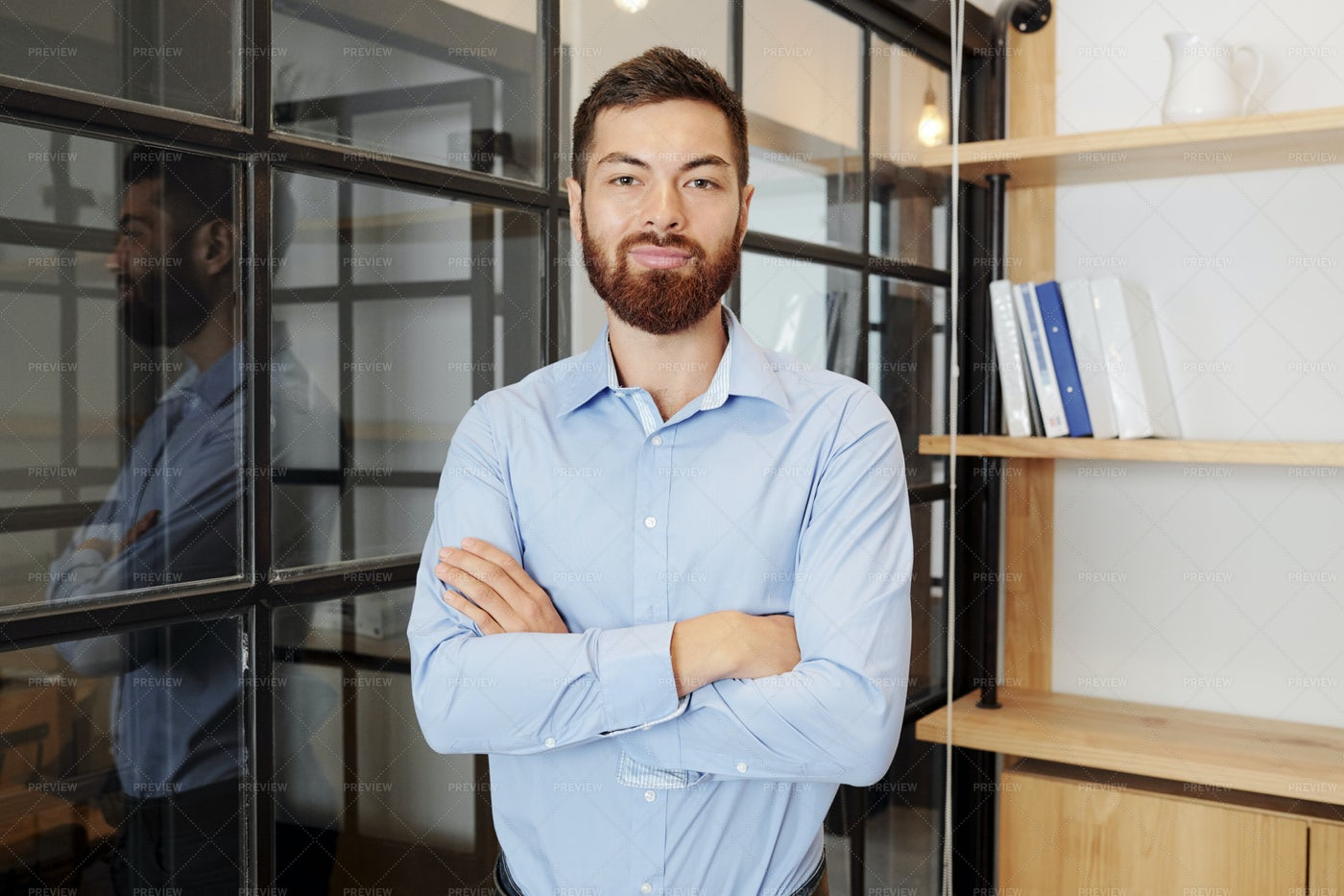 Young Manager Standing At Office: Stock Photos