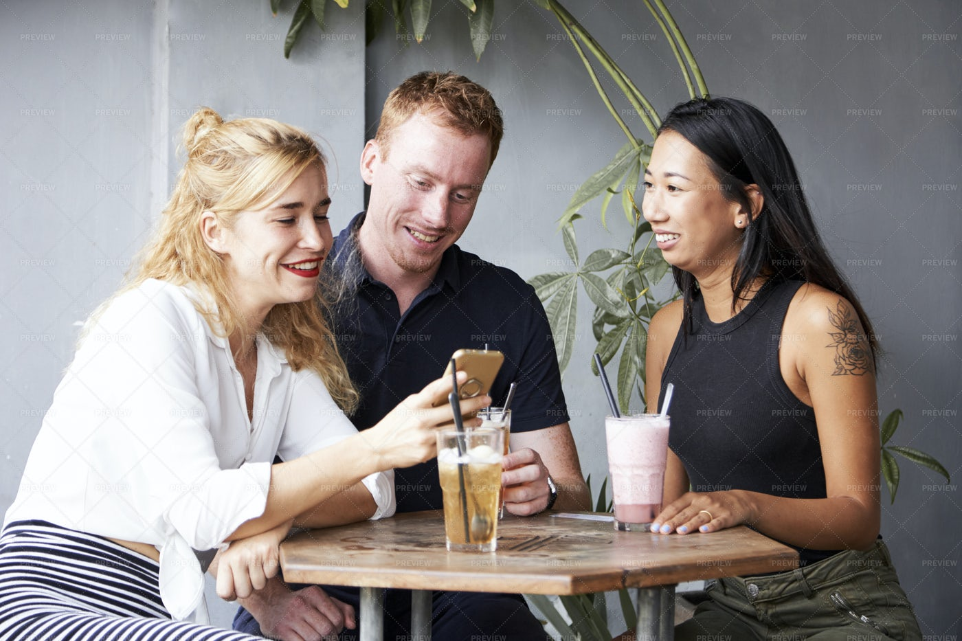 Cheerful Friends Resting In Cafe: Stock Photos