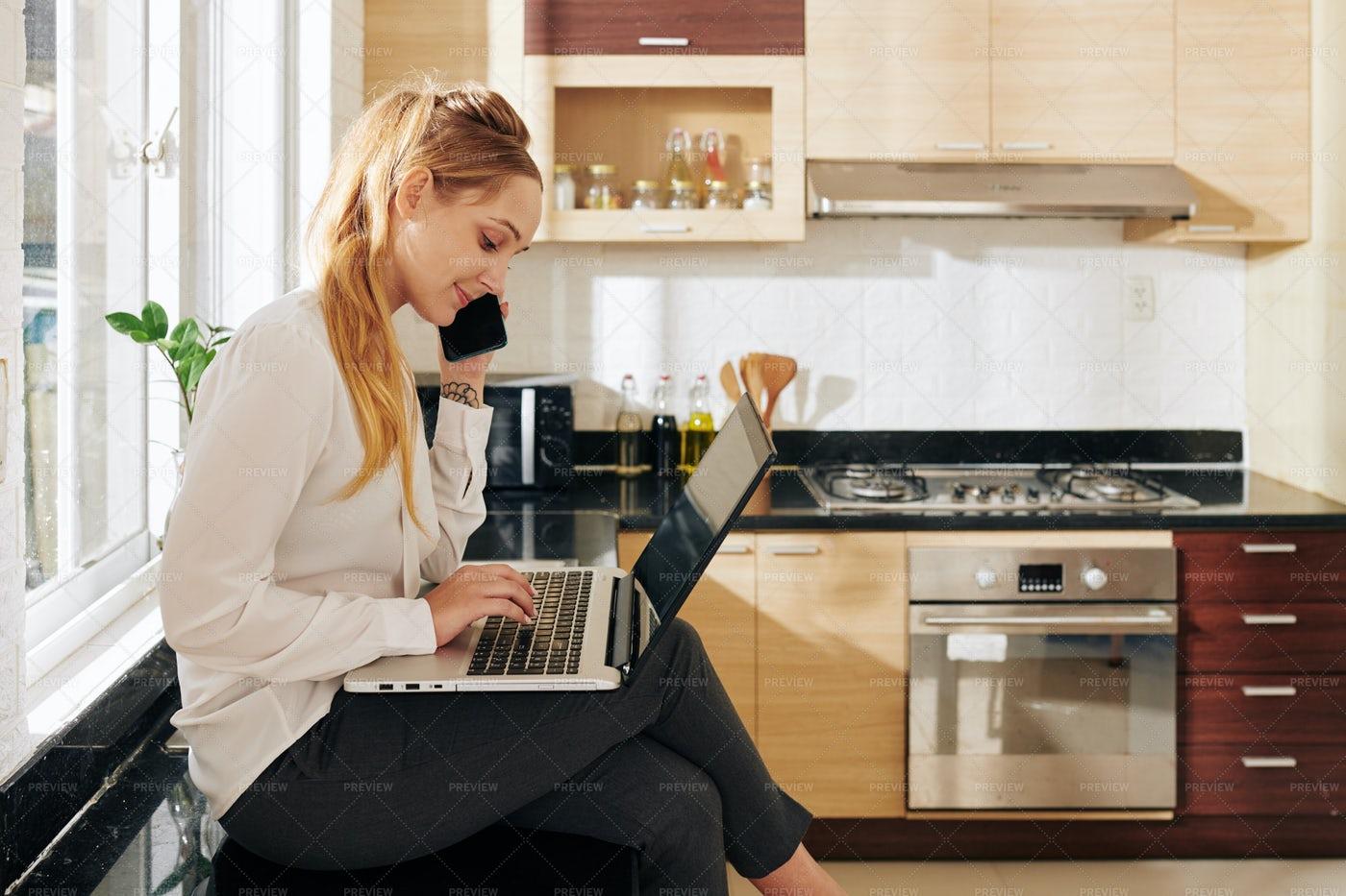 Businesswoman Working In Kitchen: Stock Photos