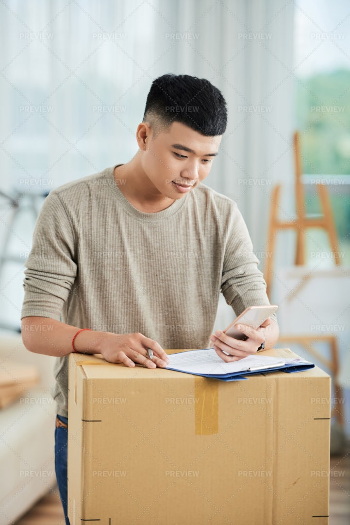 Man Filling The Form For Delivery: Stock Photos