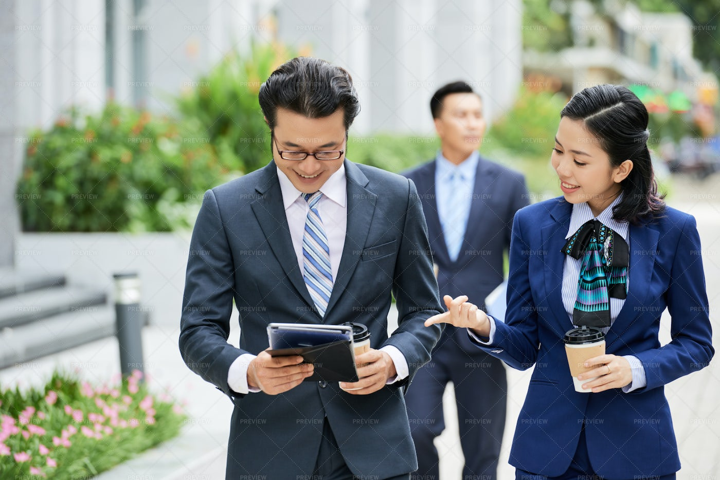 Business People Discussing Online Work: Stock Photos