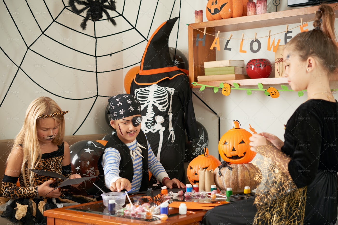 Friends Making Crafts For Halloween: Stock Photos