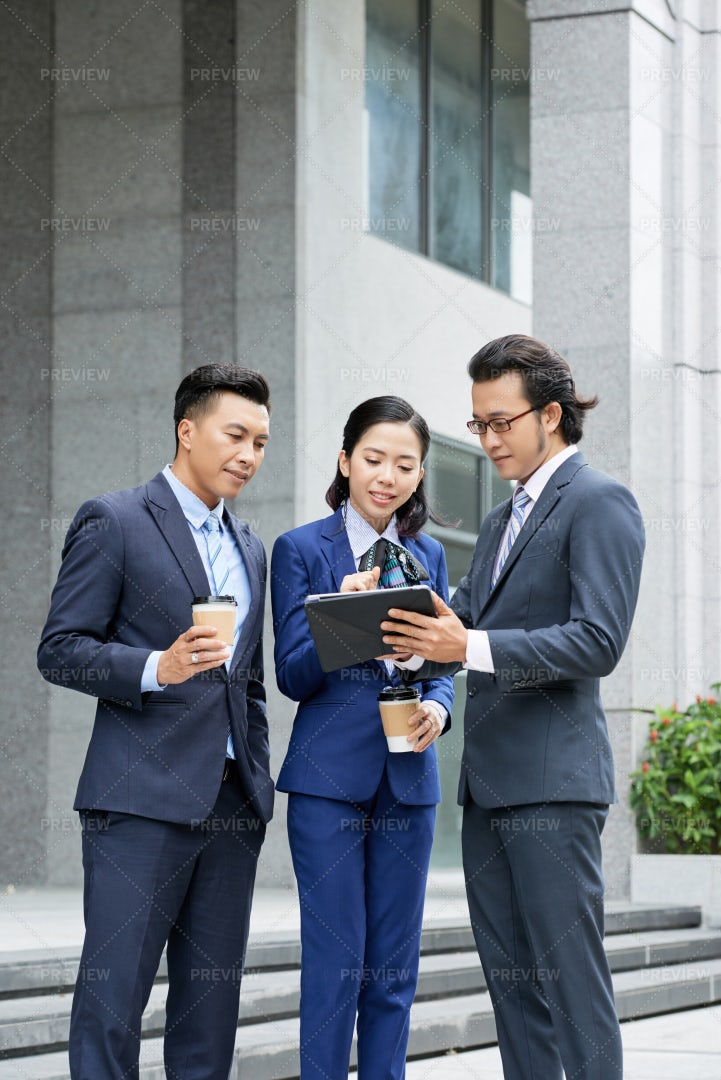 Business Partners Discussing Online: Stock Photos