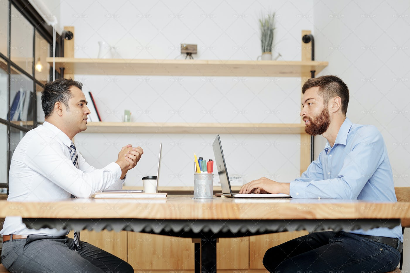 Business Partners Using Laptop In Work: Stock Photos