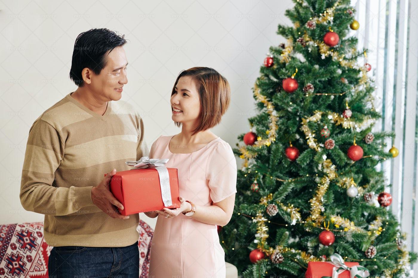 Couple Celebrating Christmas: Stock Photos