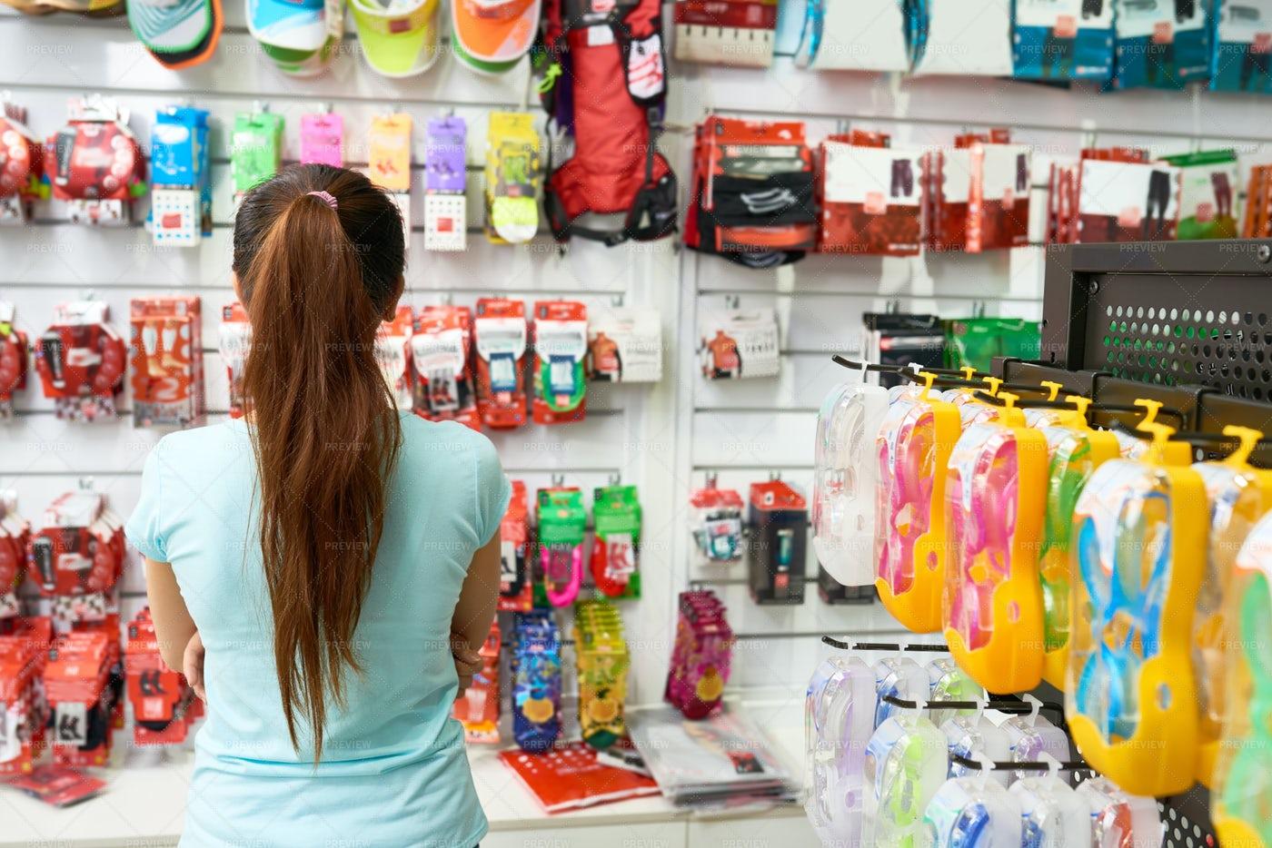 Customer Choosing Accessories: Stock Photos