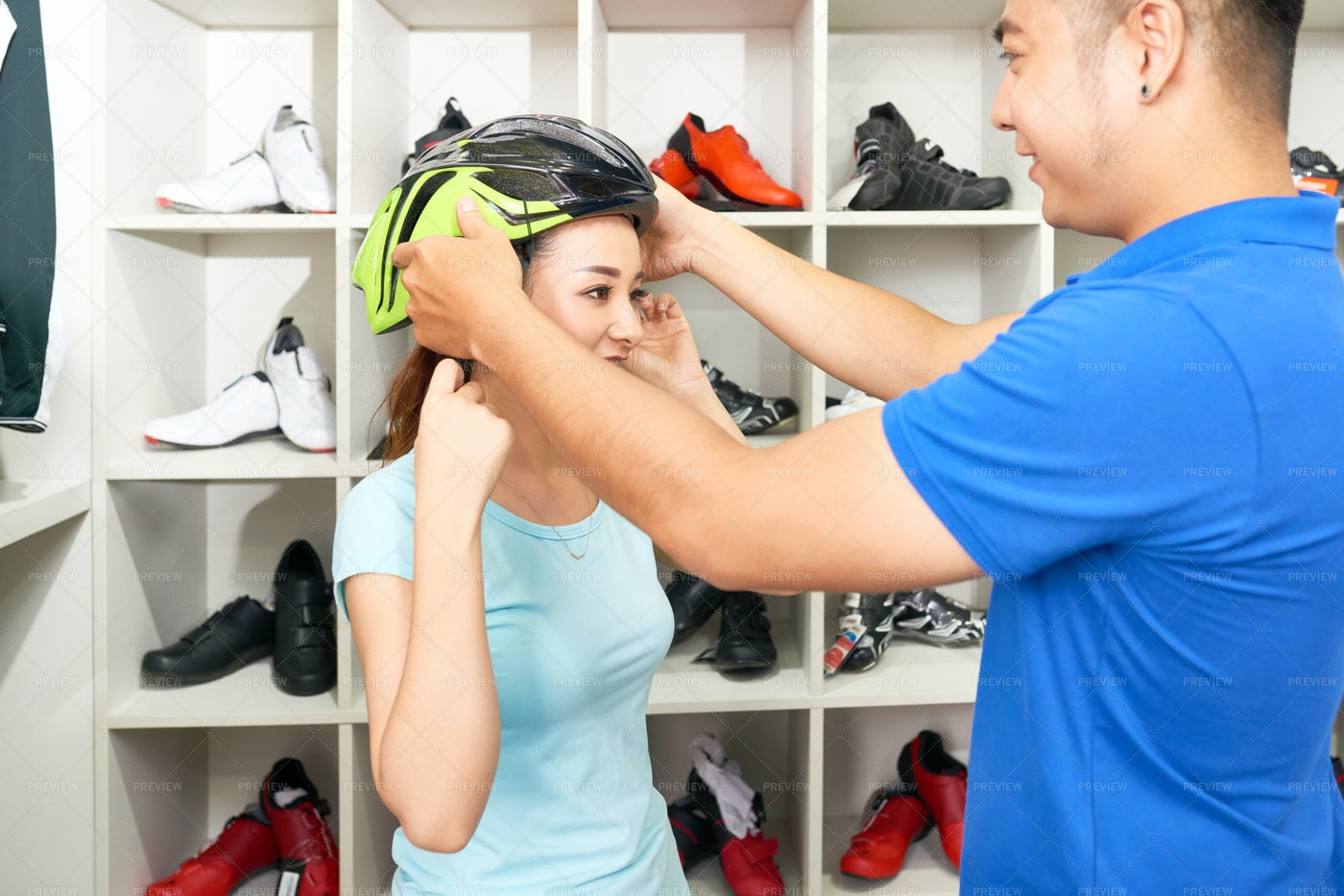 Helping To Choose Helmet: Stock Photos