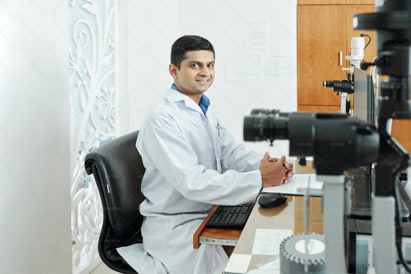 Indian Doctor Working At Office: Stock Photos