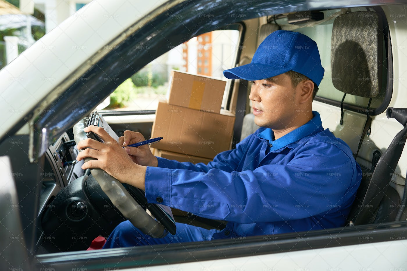 Delivery Man Filing Document: Stock Photos