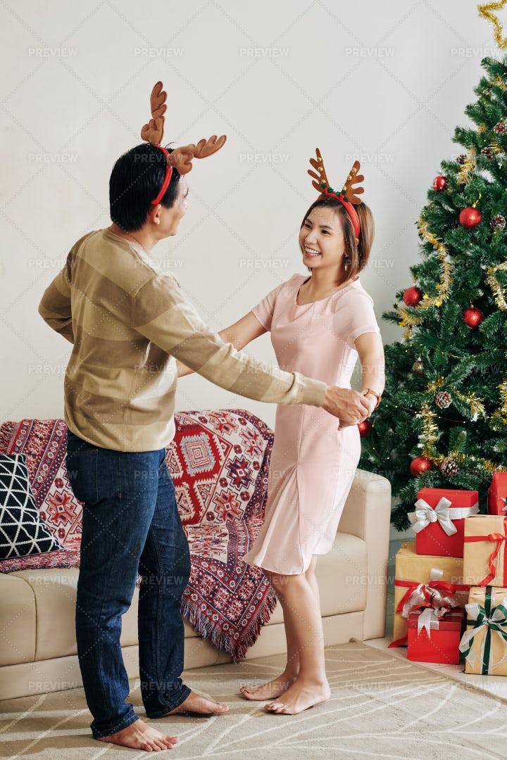 Couple Enjoying Christmas Dance: Stock Photos