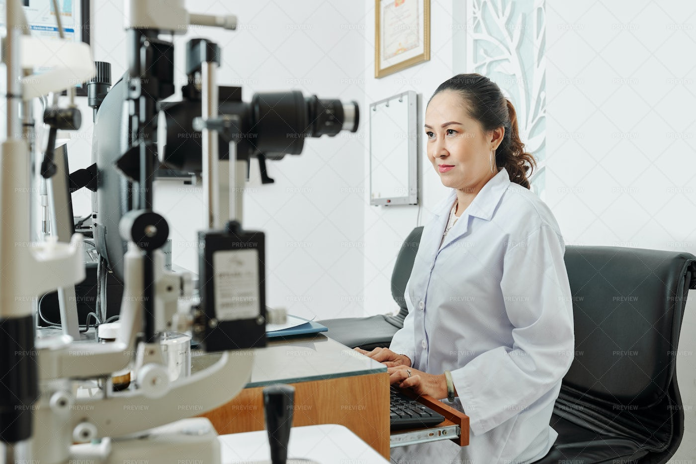 Ophthalmologist Working At Office: Stock Photos