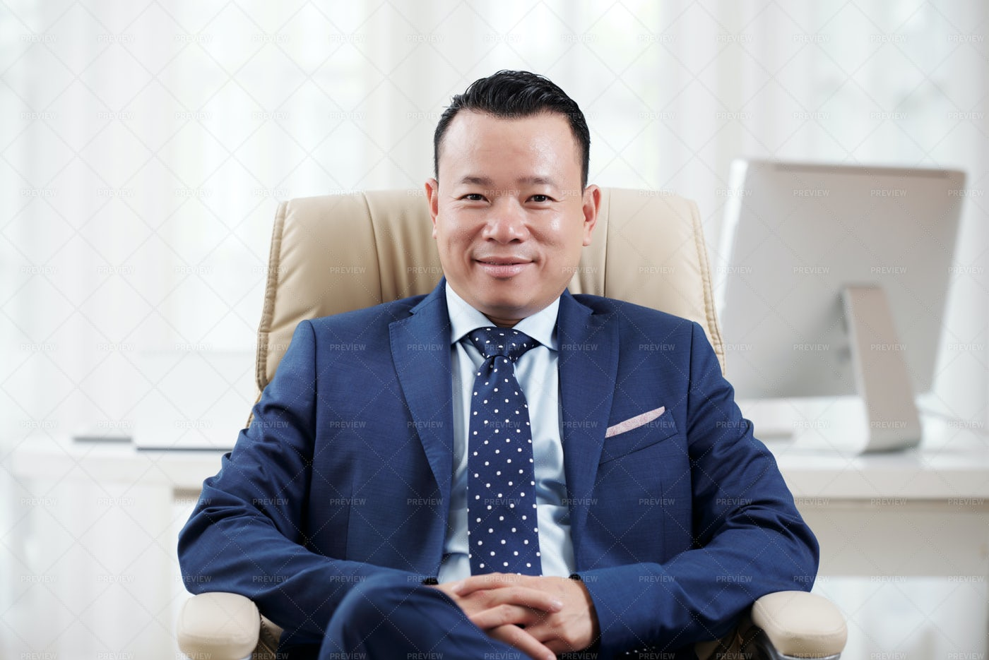 Successful Asian Leader Sitting At: Stock Photos