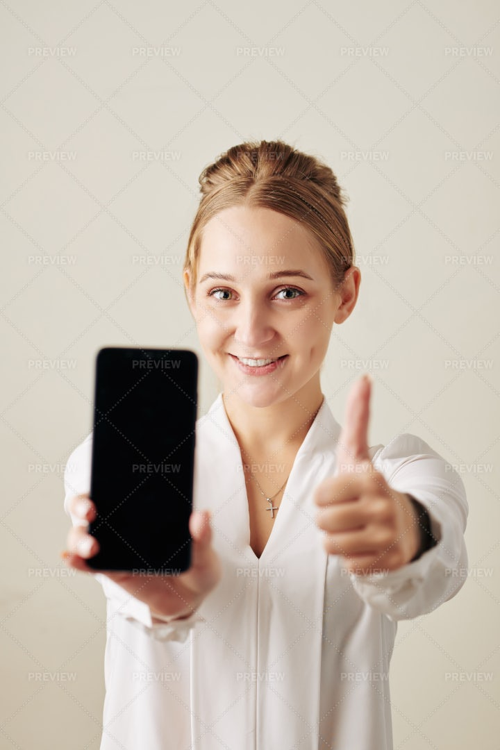 Happy Woman Showing Smartphone: Stock Photos