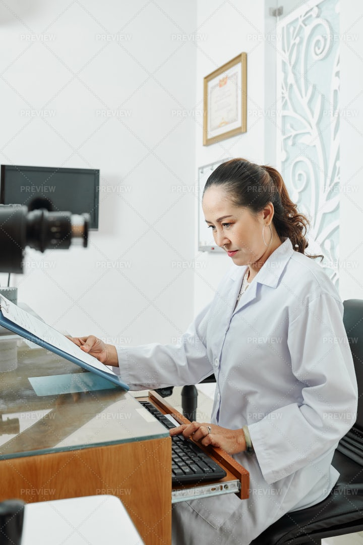 Asian Doctor Typing On Computer: Stock Photos
