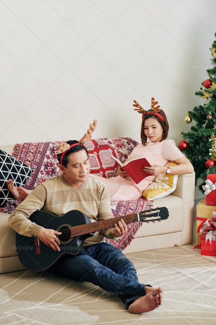 Couple Spending Christmas At Home: Stock Photos